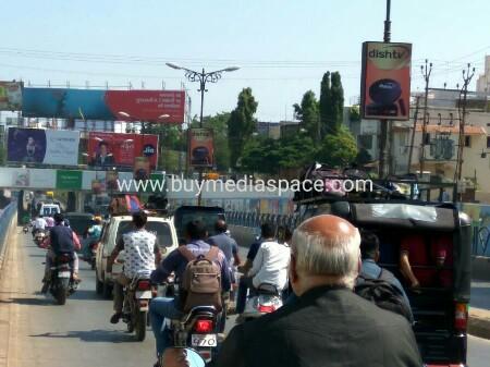 Lamppost OOH advertising in mahila college underbridg,Rajkot, Gujarat, India