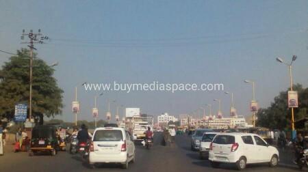 Lamppost OOH advertising in kuvadva Road, kesari Hind,Rajkot, Gujarat, India